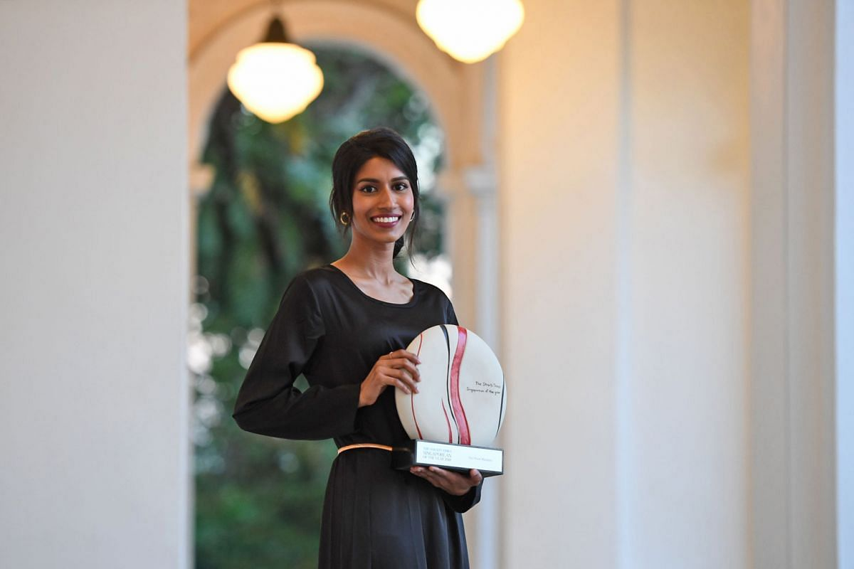 Ms Noor Mastura with her Straits Times Singaporean of the Year award (above) earlier this year.