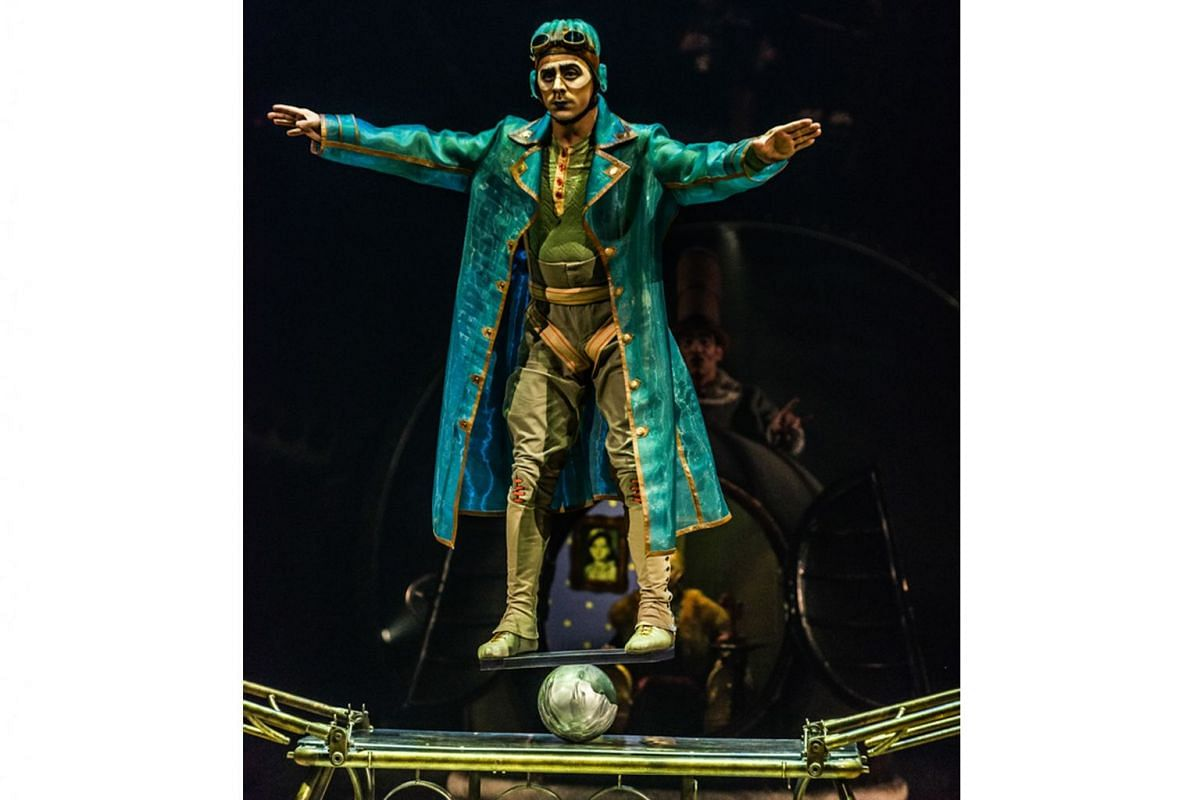 Some of the death-defying acts include the Aerial Bicycle, where a girl dangles on a bike in the air; the Upside Down World, where a man is perched on the back of a chair atop a pile of chairs; and the Rola Bola act (above), where an acrobat balances on a