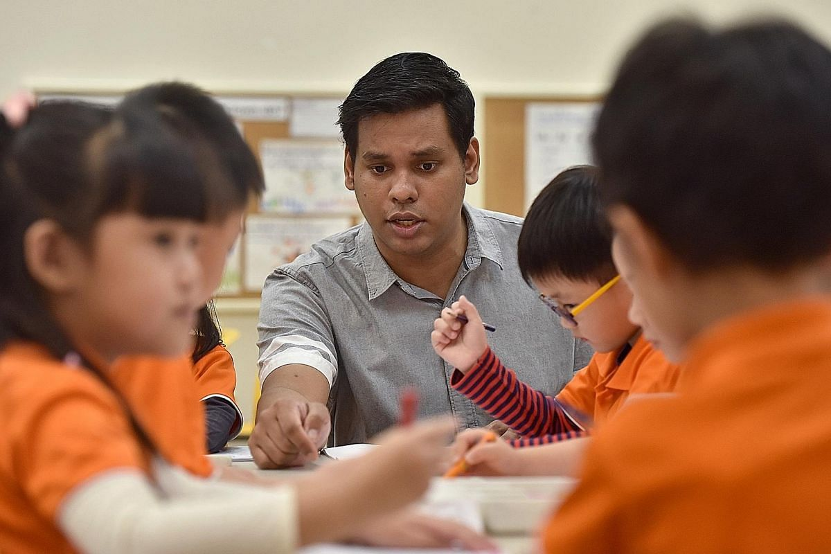 Mr Kumaran Karapaya with his pupils at NTUC First Campus' My First Skool in Westgate mall.