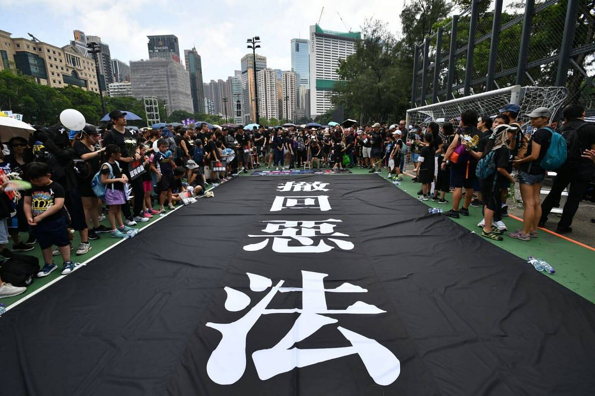 Protesters at Victoria Park waiting for the march to Hong Kong's central government offices in Admiralty, on June 16, 2019.