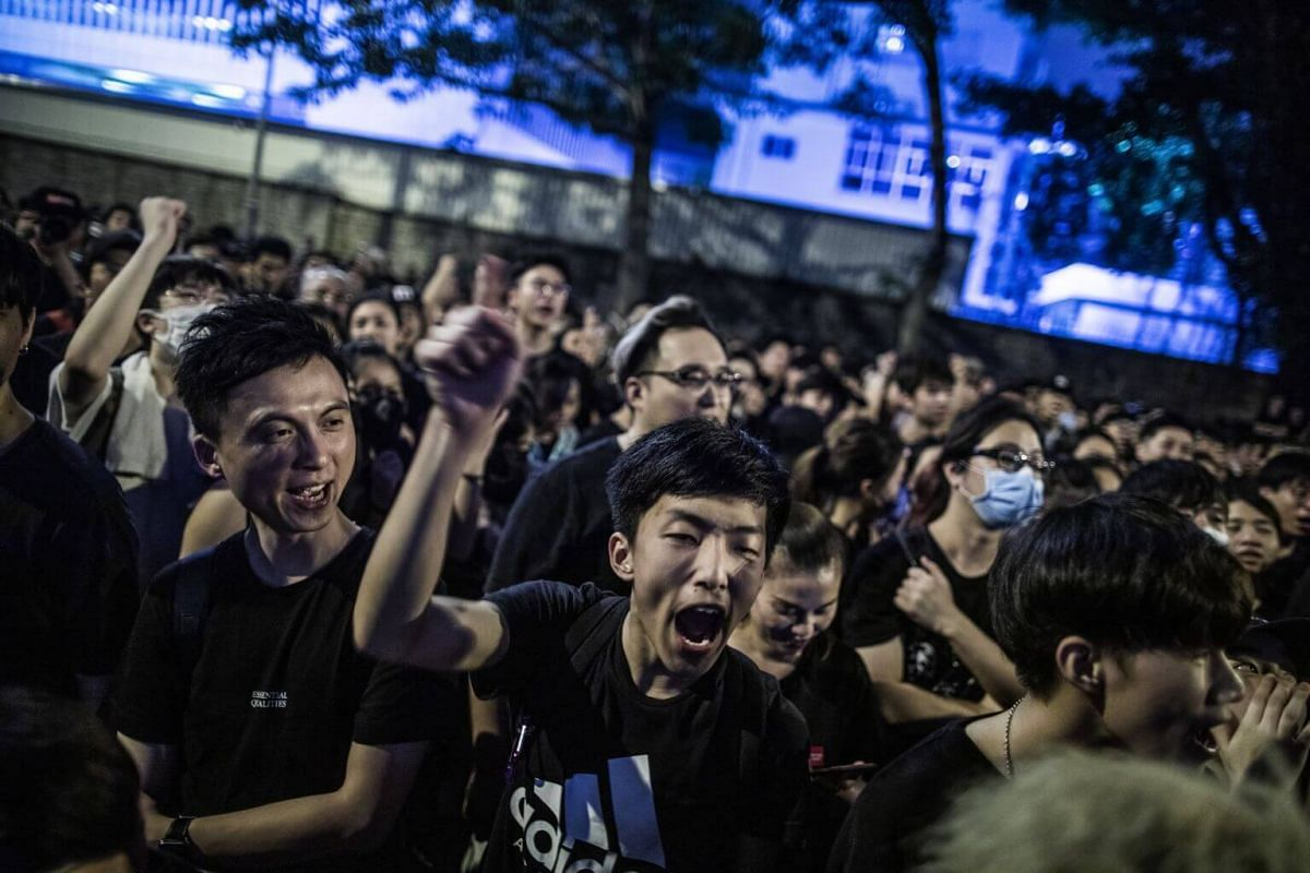 Protesters chant while gathering outside of the Office of the Chief Executive during a rally in Hong Kong, on June 16, 2019.