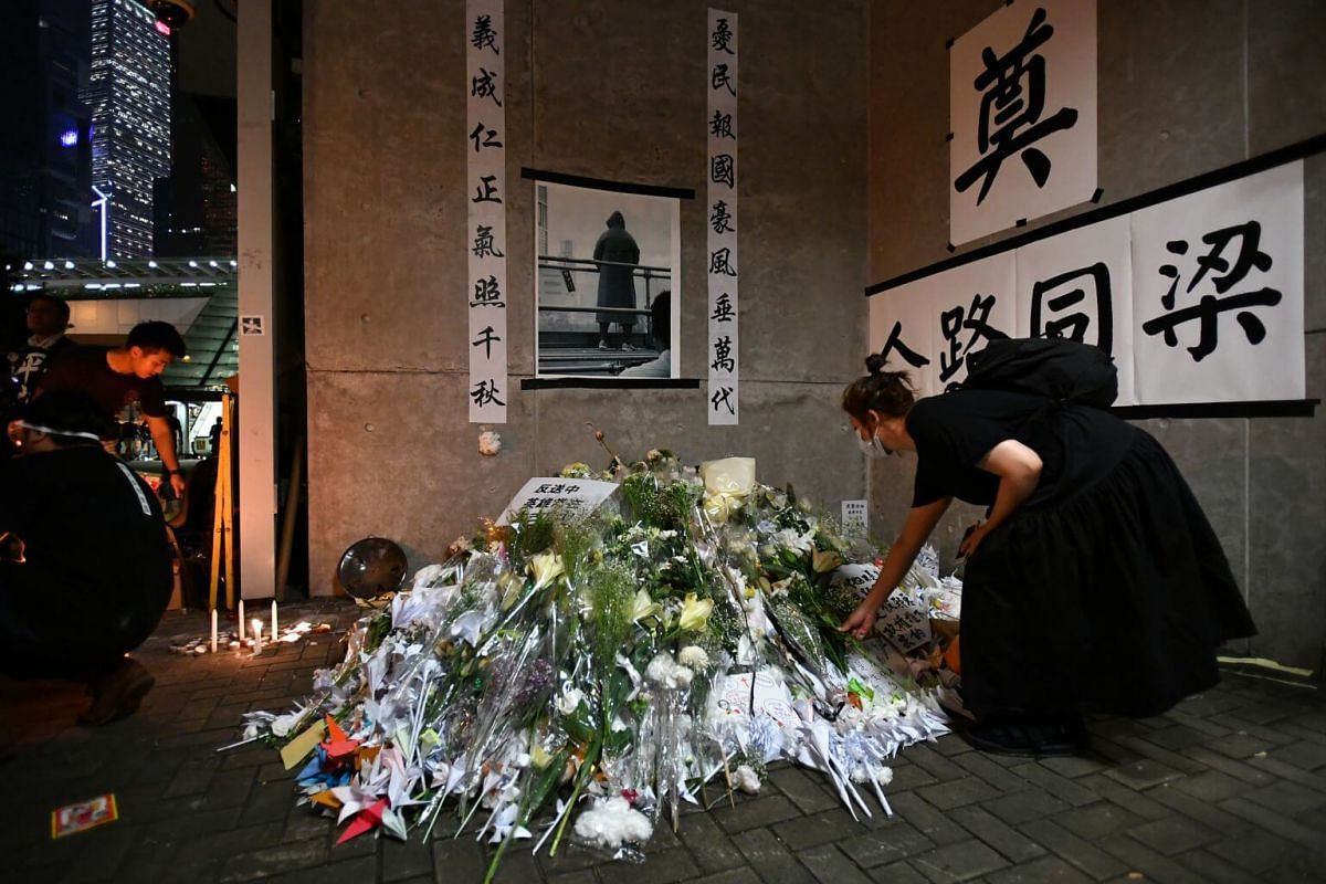 Protesters holding a memorial at the Lennon Wall near Hong Kong's central government offices in Admiralty, Hong Kong, on June 16, 2019.