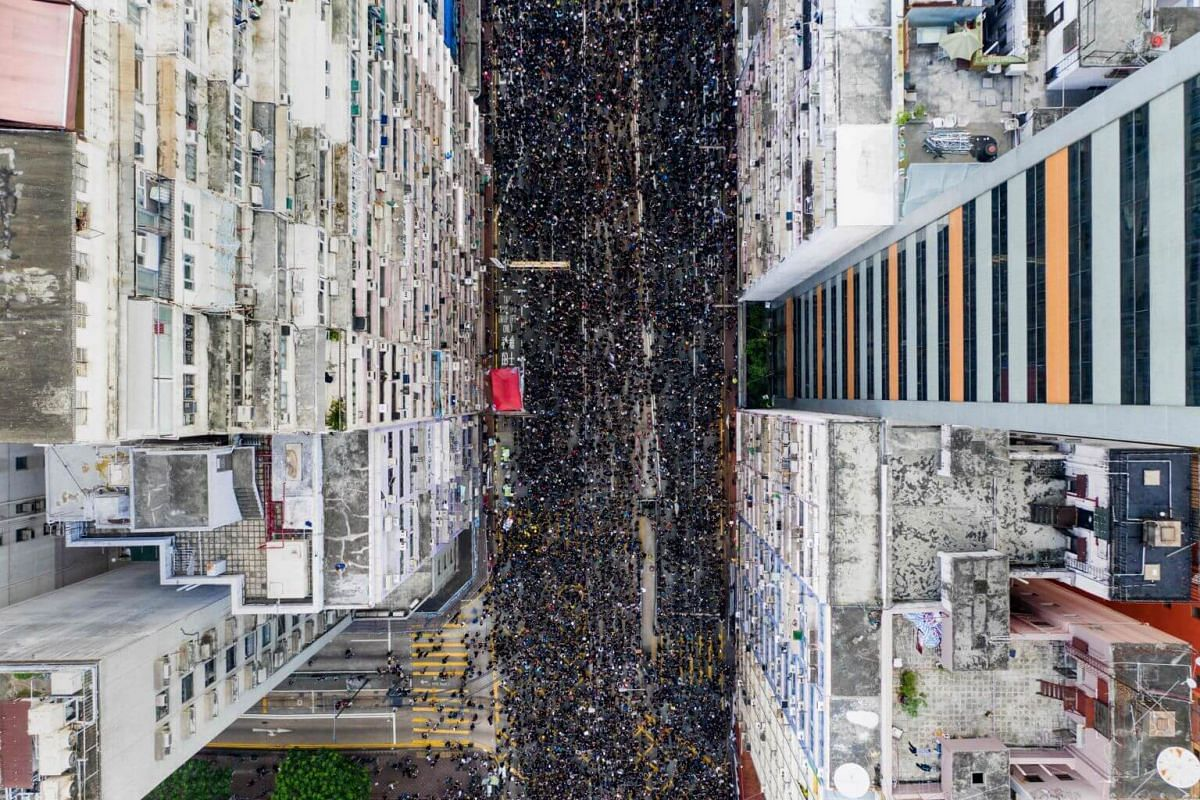 Thousands of protesters marching through the street in Hong Kong, on June 16, 2019.