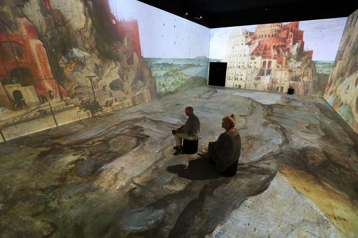 "People visit the immersive exhibition ""Beyond Bruegel"" created by ""CREATE.eu"" in Brussels, Belgium June 19, 2019. PHOTO: REUTERS"