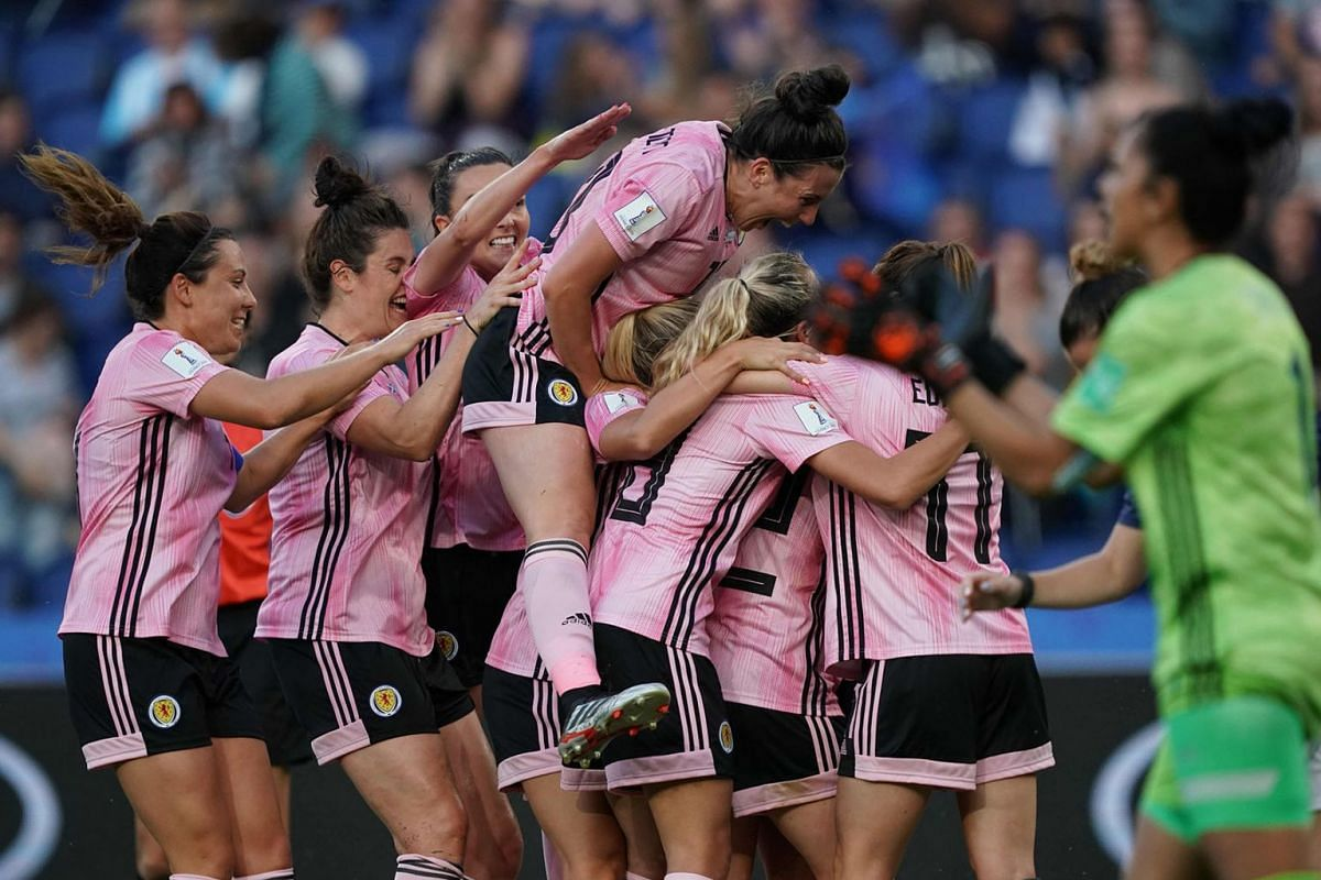 Scotland's midfielder Kim Little (hidden) is congratulated by teammates after scoring a goal during the France 2019 Women's World Cup Group D football match between Scotland and Argentina, on June 19, 2019, at the Parc des Princes stadium in Paris. P