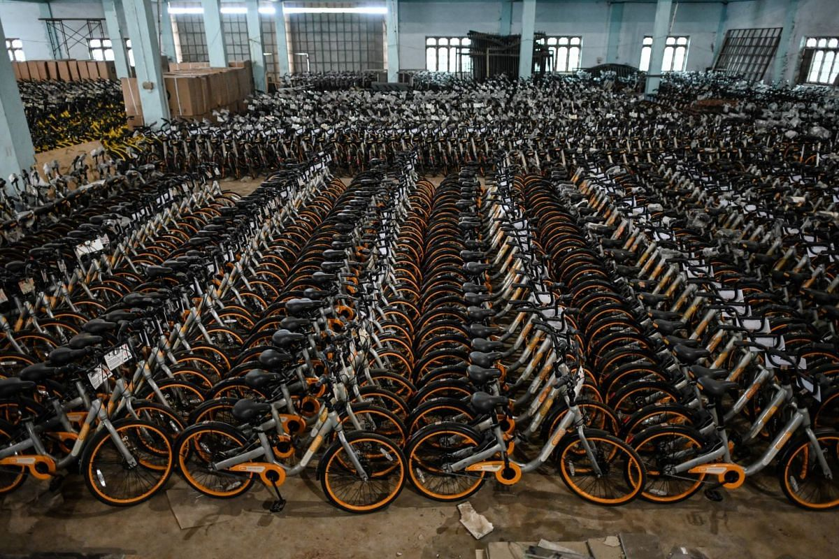 Bicycles previously used in bike-sharing companies are stored in a warehouse in Yangon, on June 15, 2019.