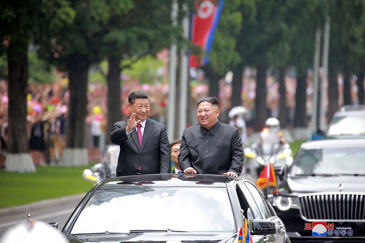North Korean leader Kim Jong Un welcomes Chinese President Xi Jinping at the Pyongyang International Airport in Pyongyang, North Korea, in this undated photo released on June 21, 2019 by North Korea's Korean Central News Agency (KCNA). PHOTO: HANDOUT