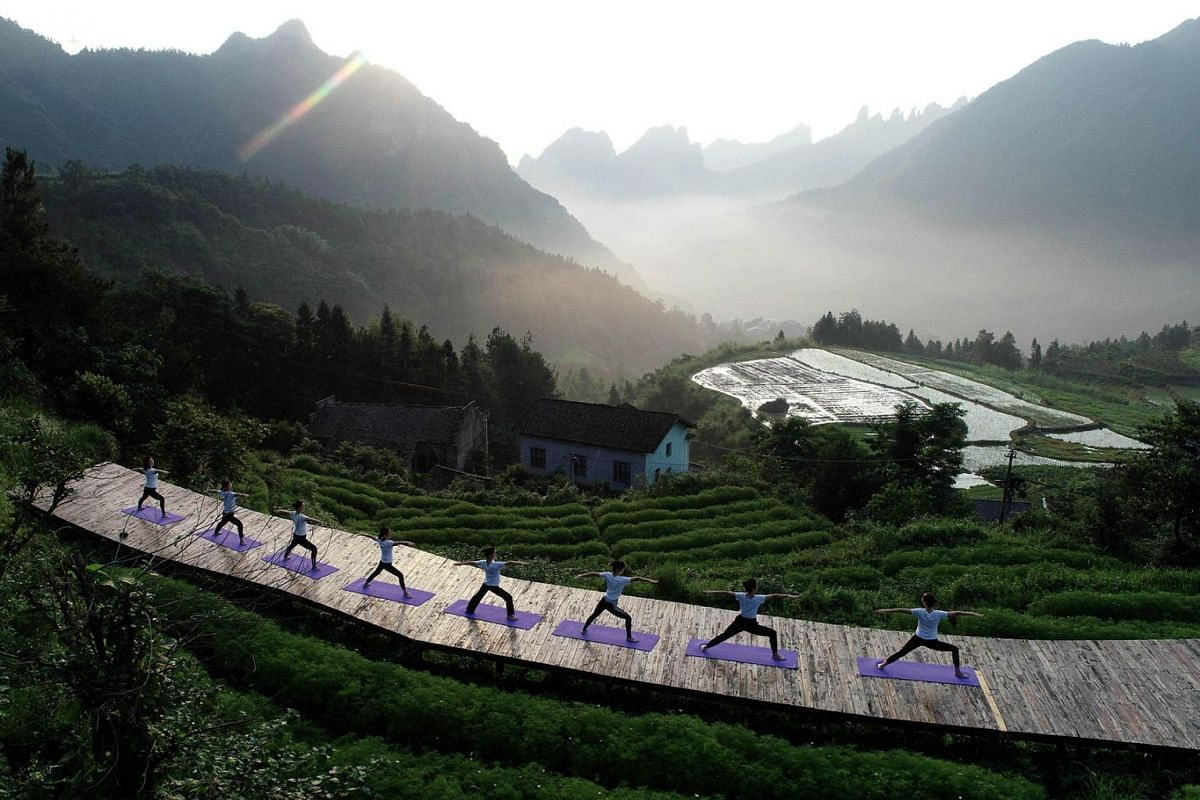 Yoga enthusiasts practice yoga in the mountain village of Qiqi in Zhangjiajie, China's central Hunan Province, on June 20, 2019. PHOTO: AFP