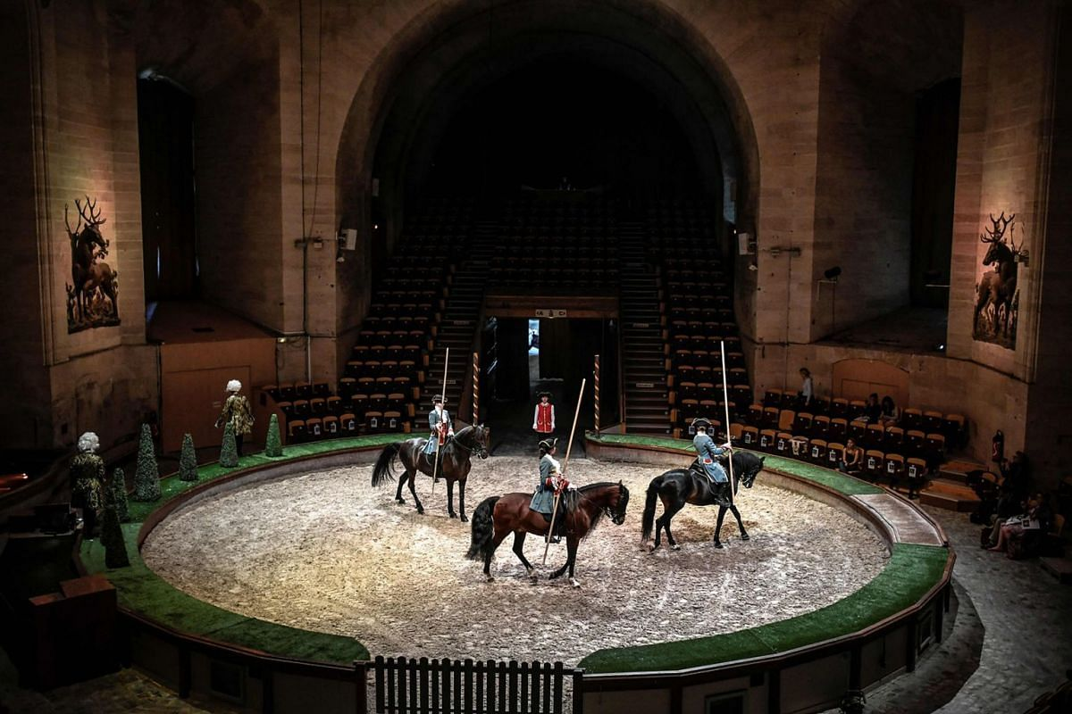 Riders perform during the rehearsal of their show at the Great Stables of Chantilly, north of Paris, on June 18, 2019. PHOTO: AFP