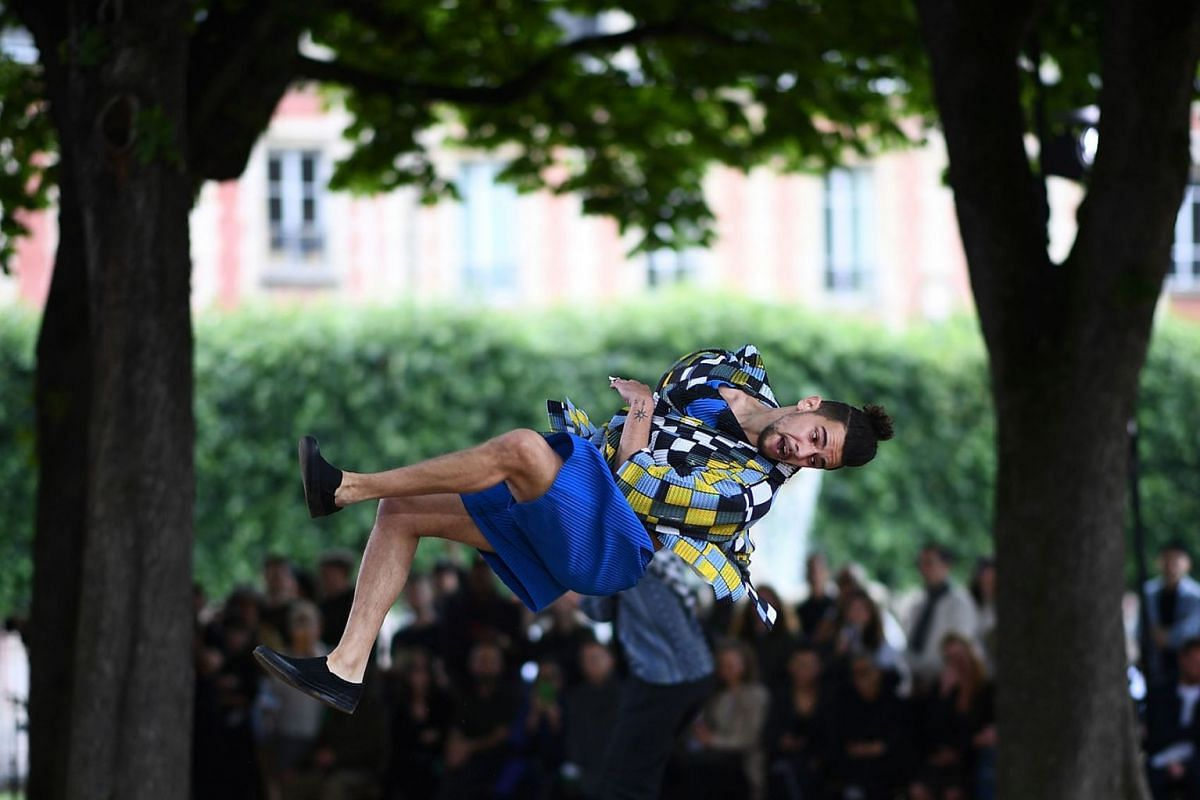 A model performs as he presents a creation for Homme Plisse by Japanese fashion house Issey Miyake during the Men's Spring/summer 2020 fashion collection on June 20, 2019 in Paris. PHOTO: AFP