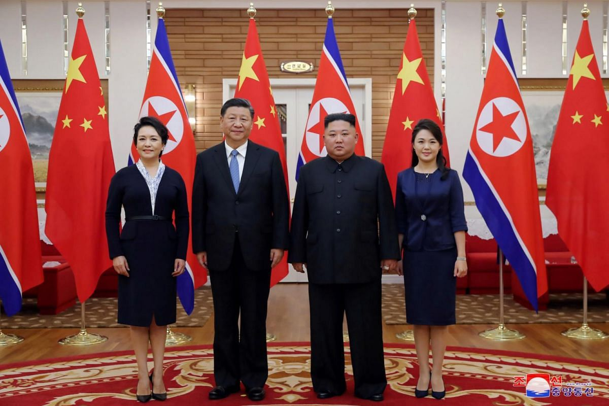 Chinese President Xi Jinping and his wife Peng Liyuan (left) pose with North Korean leader Kim Jong Un and his wife Ri Sol Ju in this undated photo released on June 21, 2019.