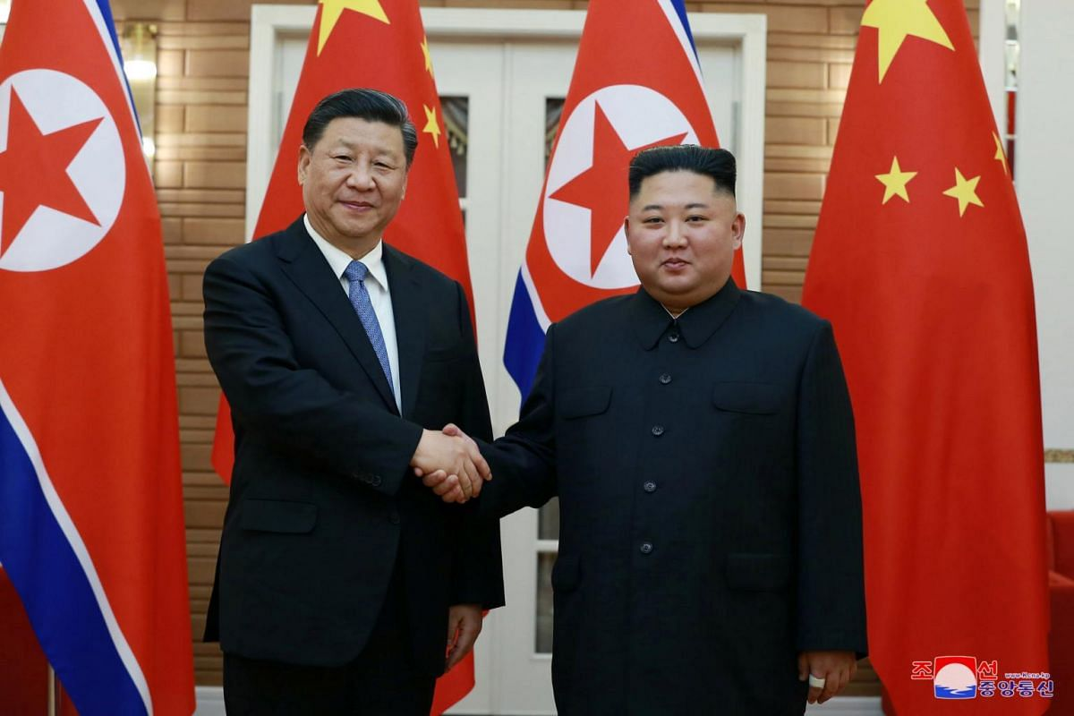 North Korean leader Kim Jong Un shakes hands with China's President Xi Jinping in this undated photo released on June 21, 2019.