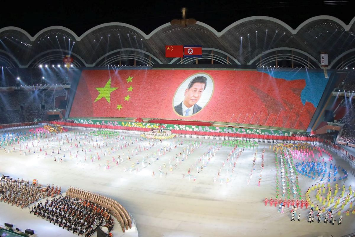 A mass display is held showing the image of China's President Xi Jinping in this undated photo released on June 21, 2019.