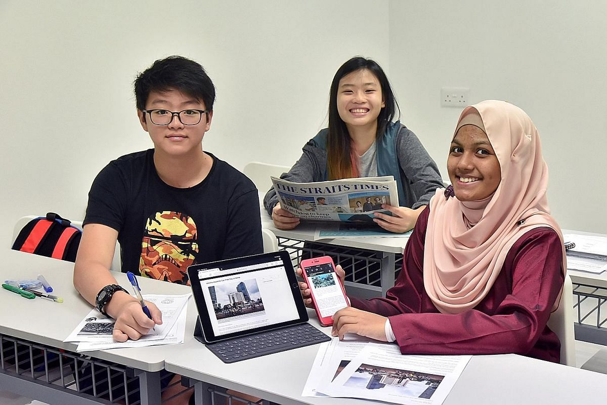 The Straits Times is one of the resources students at enrichment centre Write Edge (from far left), Daryl Wong, Sarah Teo and Fatimah Ramadhan, use to improve their vocabulary and communication skills.