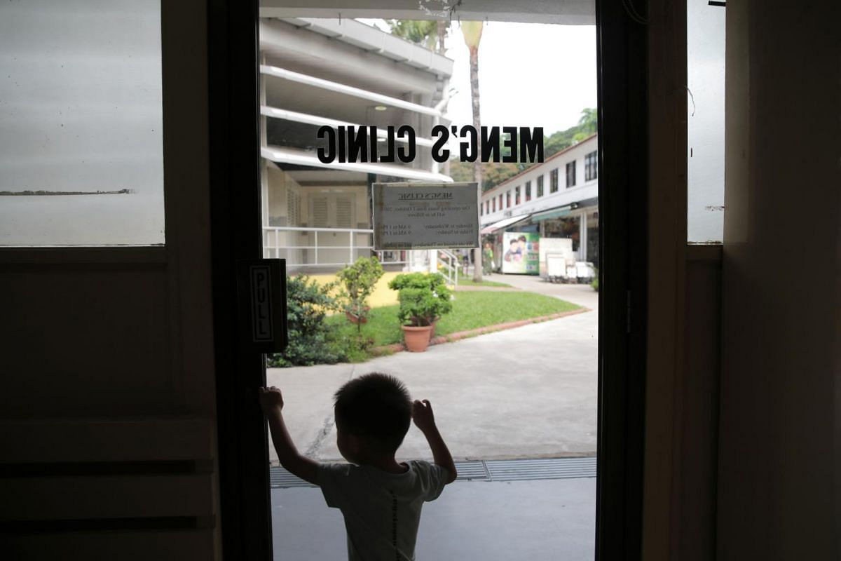 Austin Tan, three, stands by the door at Meng's Clinic on June 21, 2019. He is the fourth generation of his family to see Dr Chan, whom he addresses as 'ye ye' (grandfather in mandarin).
