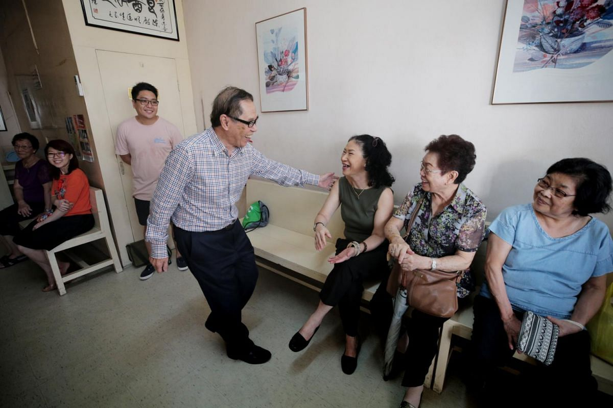 Dr Chan Khye Meng, 86, greets well-wishers comprising his patients past and present, in his clinic during a thank you event on June 23, 2019.