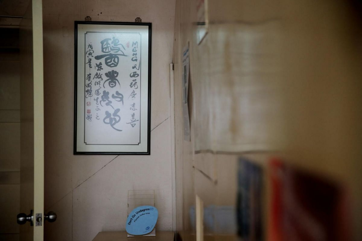 Calligraphy, a gift from a patient, adorns the walls of Meng's Clinic, pictured on June 21, 2019.