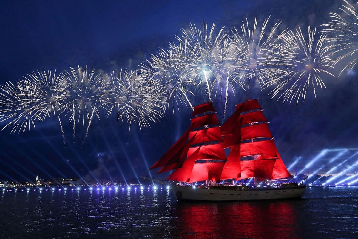 """Fireworks explode over the Brig """"Rossiya"""" (Russia) as it floats on the Neva River during the Scarlet Sails festivities marking school graduation in Saint Petersburg, Russia, June 24, 2019. PHOTO: REUTERS"""