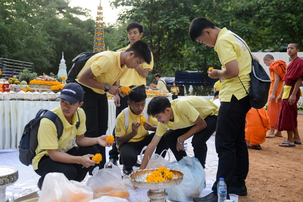 Members of the Wild Boars football team prepare flowers for a traditional ceremony to mark the first anniversary of their rescue from the Tham Luang cave in the Mae Sai district of Chiang Rai province on June 24, 2019.