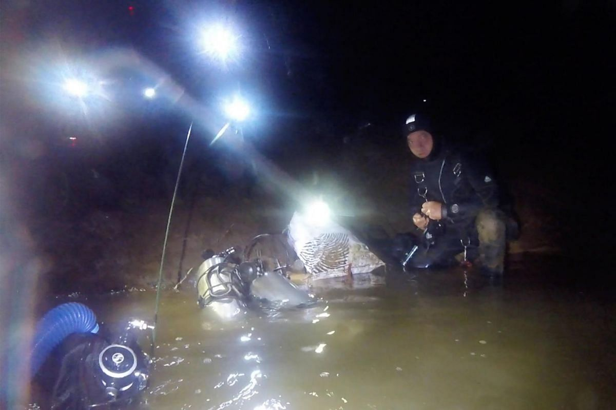 """This handout picture from diver Ben Reymenants taken during the June-July 2018 rescue of the 12 boys from the """"Wild Boars"""" football team and their coach trapped in the Tham Luang cave shows the rescue efforts in a cave in the Mae Sai district of Chia"""