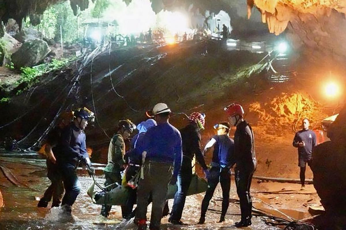"""In this undated file handout photo released by the Royal Thai Navy on July 11, 2018, one of the members of the """"Wild Boars"""" football team is carried on a stretcher during the rescue operation in the Tham Luang cave in the Khun Nam Nang Non Forest Par"""