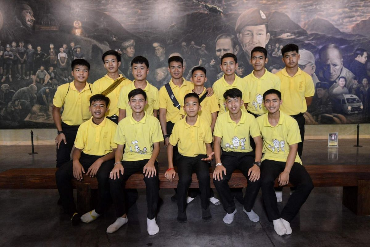 Members of the Wild Boars football team pose at the Tham Luang cave centre as they mark the first anniversary of their rescue from the cave in the Mae Sai district of Chiang Rai province on June 24, 2019.