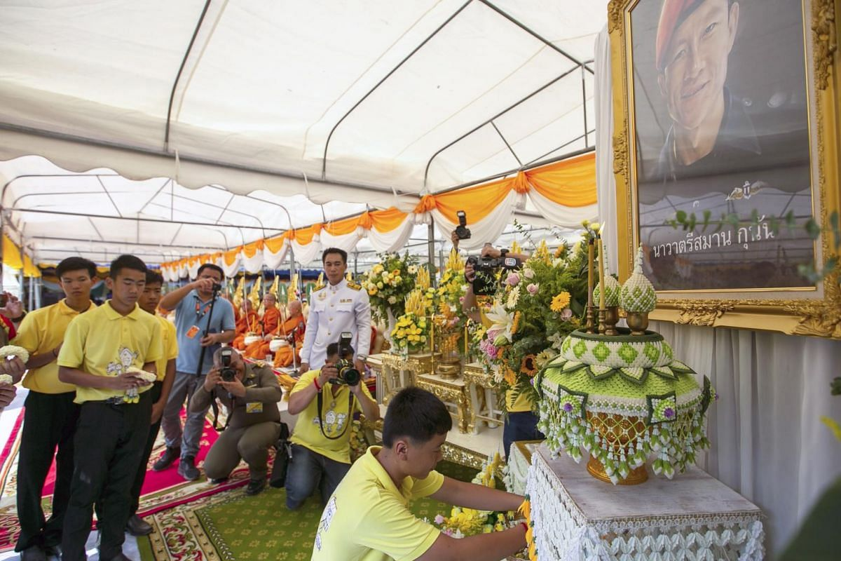 Members of the Wild Boar soccer team, who were rescued from the Tham Luang cave, offer flowers to honour former Thai Navy Seal Officer Saman Kunan, who died in the Tham Luang cave rescue operation. This took place during a religious ceremony to mark