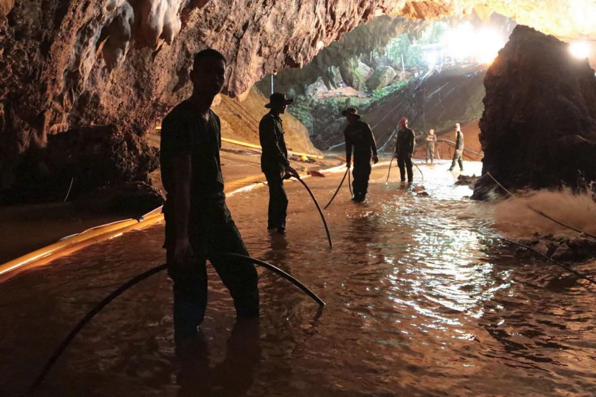 A handout photo made available by the Thai Royal Navy shows Thai military personnel inside a cave complex during the rescue operations for the youth soccer team and their assistant coach, at Tham Luang cave in Khun Nam Nang Non Forest Park, Chiang Ra