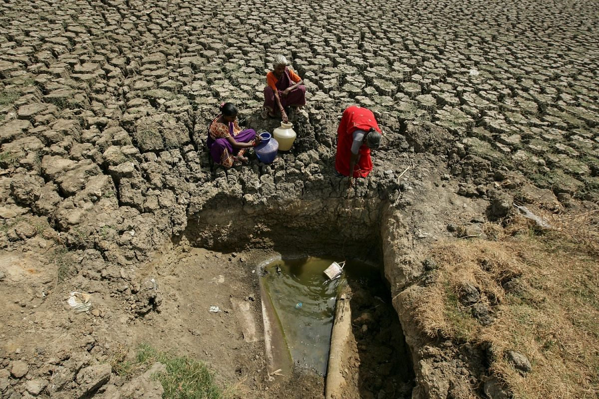 Women fetching water from a lake in Chennai that is almost totally dried up. The capital city of Tamil Nadu state has historically relied on the annual monsoon rain to replenish its reservoirs since the rivers are polluted with sewage.