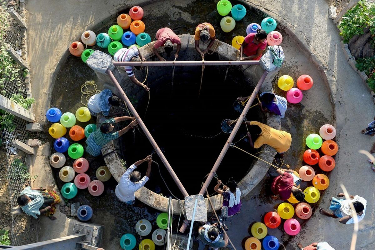Residents drawing water from a community well. The Tamil Nadu government has said it would bring water in by train from Jolarpettai, 220km away.