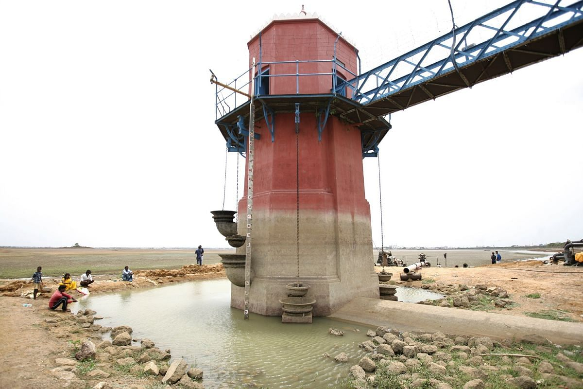 People gathering at a tower for measuring the water depth in the dried-up Puzhal reservoir in the outskirts of Chennai last Thursday.