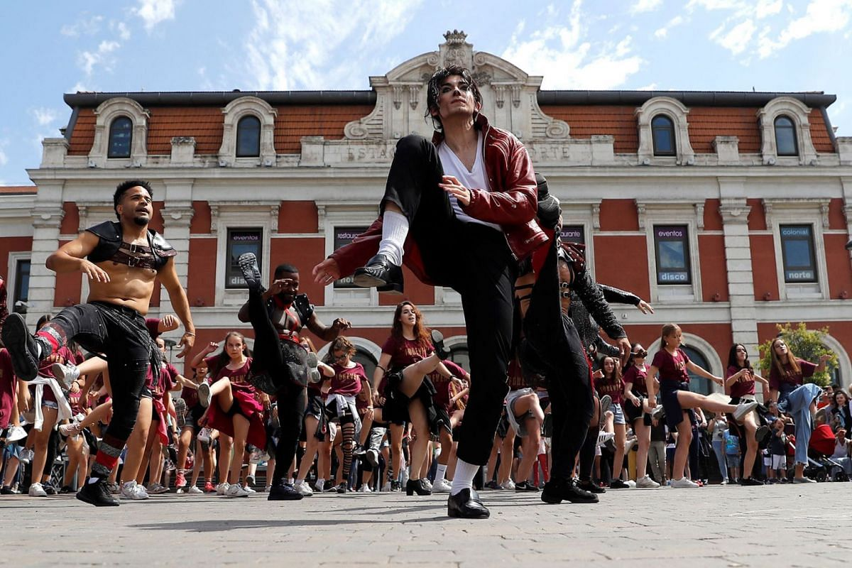 Dancers from the musical 'Forever' take part in a flashmob performed as a tribute to US artist Michael Jackson on the occasion of the 10th anniversary of his death, in Madrid, Spain, 25 June 2019. EPA-EFE