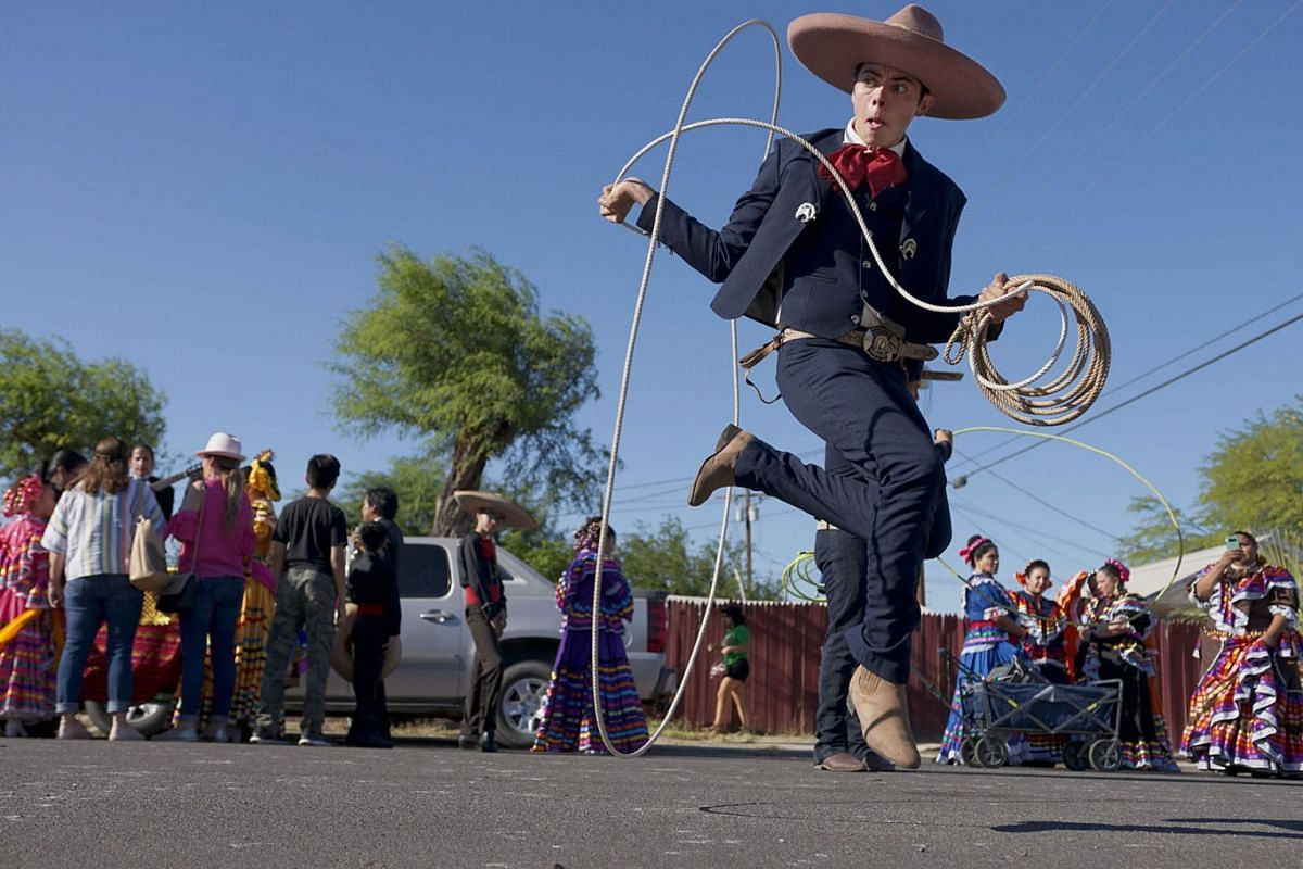 A photo issued on June 25, 2019 shows Ballet Folklorico dancers preparing to march in a homecoming parade for Heavyweight boxing champion Andy Ruiz Jr. on June 22, 2019 in Imperial, California. PHOTO: AFP