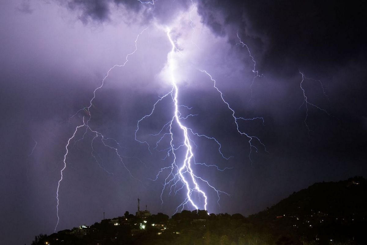 Lightning strikes during an electrical storm over Port-au-Prince on June 25, 2019. PHOTO: AFP