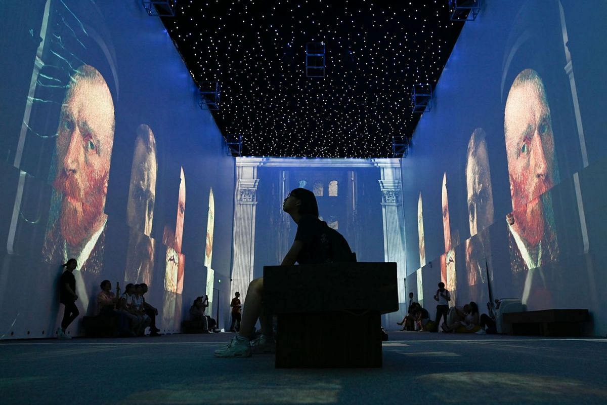 People visit an immersive exhibition about Vincent van Gogh in Beijing on June 25, 2019. PHOTO: AFP