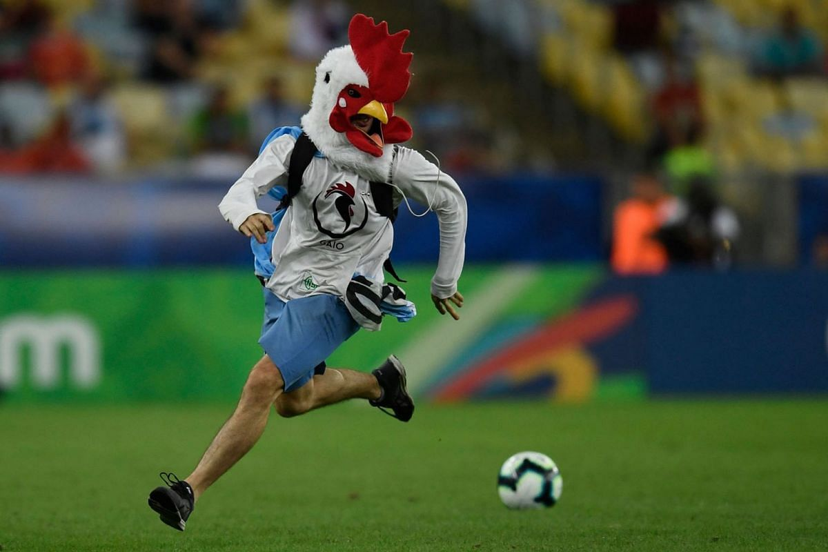 An invader runs on the field during the Copa America football tournament group match between Chile and Uruguay at Maracana Stadium in Rio de Janeiro, Brazil, on June 24, 2019. PHOTO: AFP