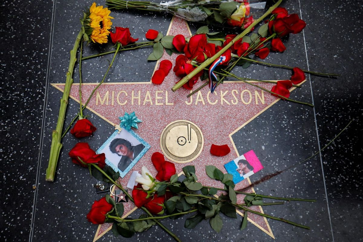 Flowers surround Michael Jackson's star on the Hollywood Walk of Fame in Los Angeles, California, on June 25, 2019.