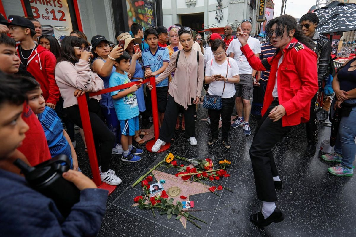 A Michael Jackson impersonator dancing next to the pop icon's star on the Hollywood Walk of Fame.
