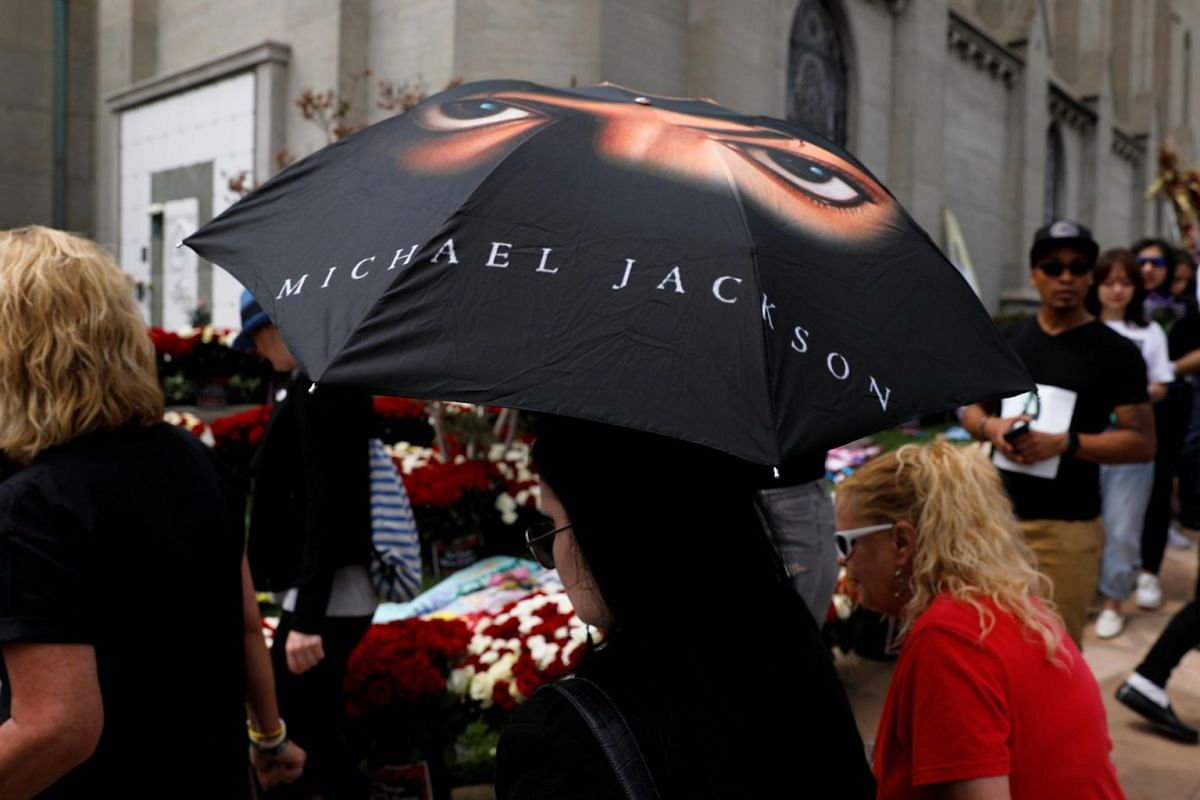 A woman with a Michael Jackson umbrella during a tribute event in Glendale, California, on June 25, 2019.