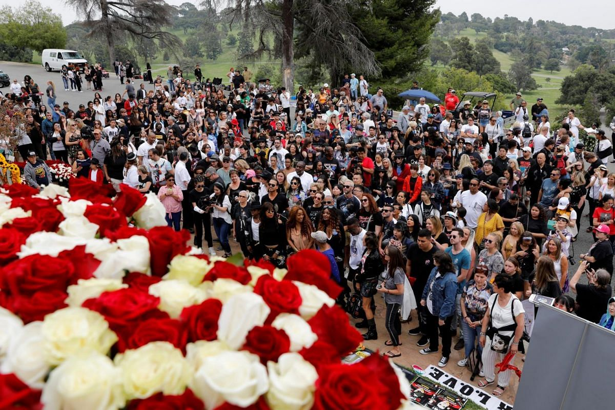 Fans gather at the Forest Lawn Cemetery in Glendale, California, where Michael Jackson is buried, for a tribute event on June 25, 2019.