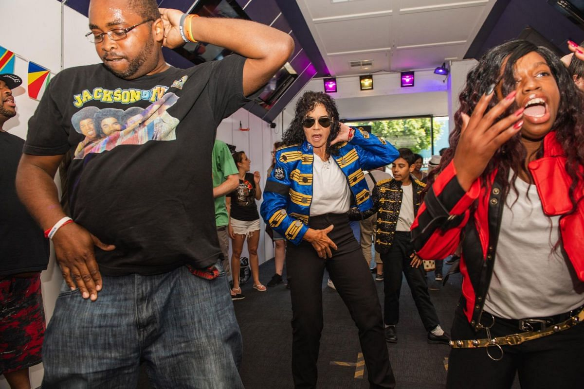 Peggy Wolf (centre) who runs a Michael Jackson dance troupe, at a gathering in Los Angeles, California, for the pop star's fans from around the world, on June 24, 2019.