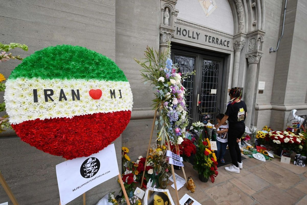 Fans gather outside Michael Jackson's final resting place at the Holly Terrace mausoleum at the Forest Lawn Cemetery in Glendale, California.