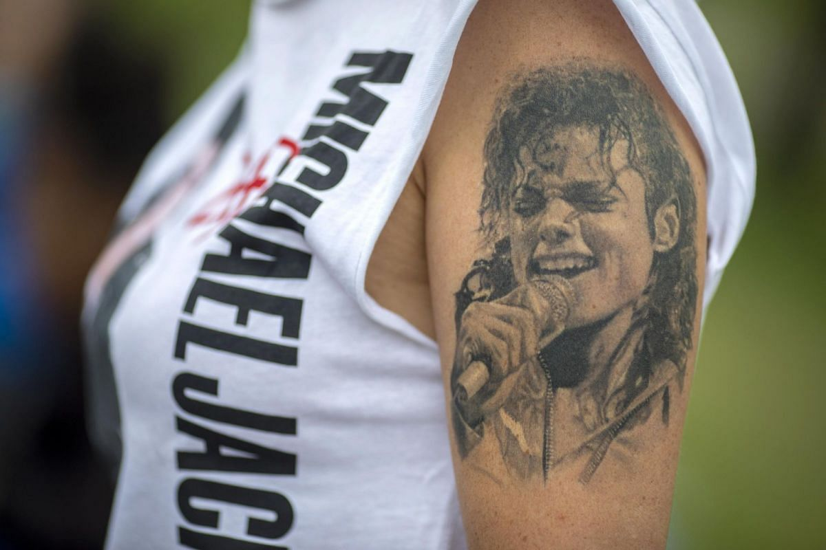 A tattoo of US pop star Michael Jackson seen on a fan at the Forest Lawn Cemetery.