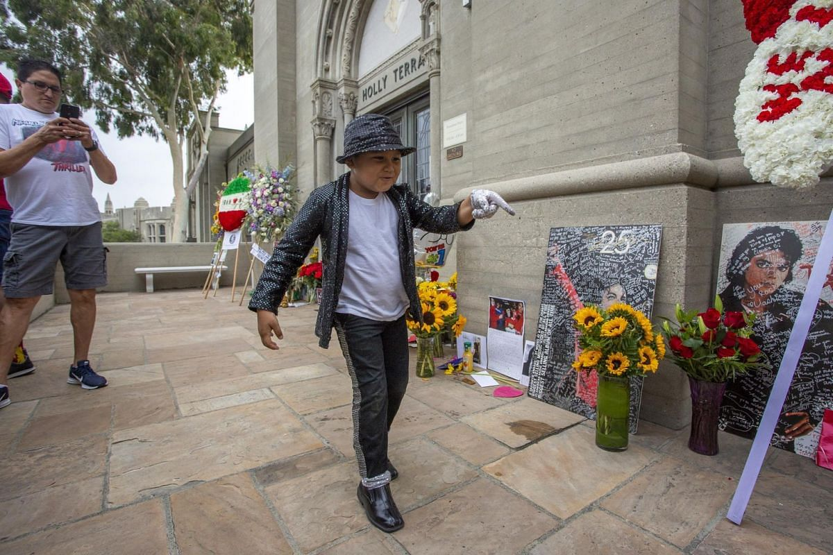 Dominic Lendo, six, doing a Michael Jackson impersonation at the Forest Lawn Cemetery in Glendale, California.
