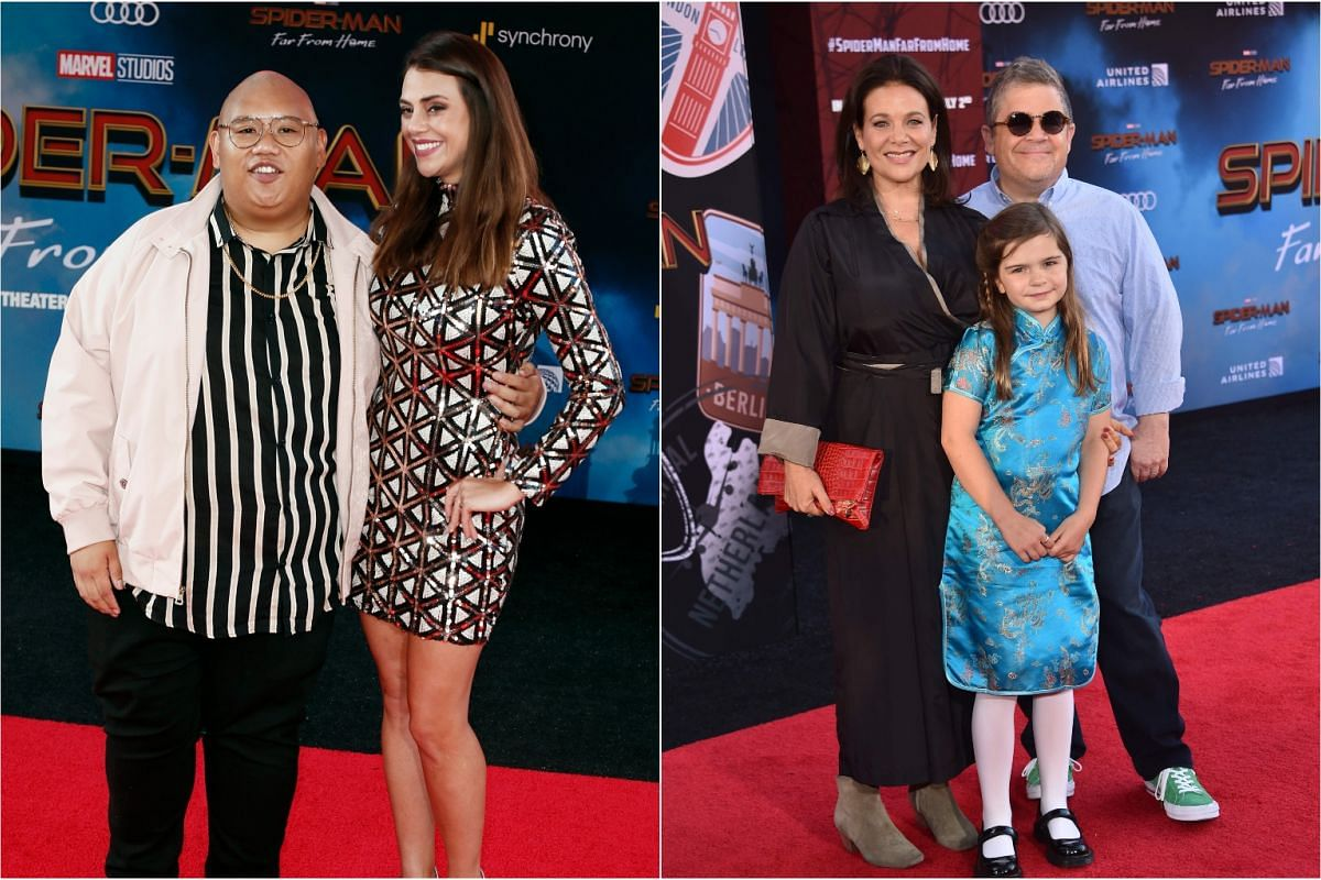 (From left) Actor Jacob Batalon, actor Patton Oswalt (right), his daughter Alice and his wife actress Meredith Salenger arrive for the Spider-Man: Far From Home world premiere at the TCL Chinese Theatre, on June 26, 2019.