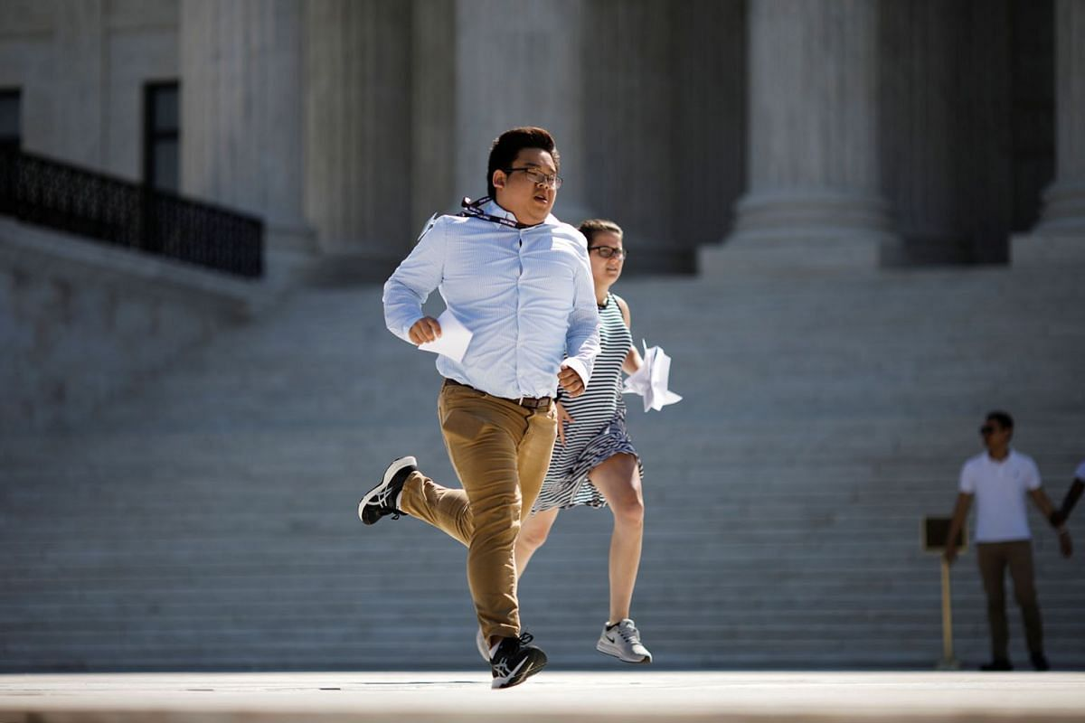 News assistants run outside the U.S. Supreme Court after the court rejected efforts to rein in the contentious practice of manipulating electoral district boundaries to entrench one party in power by turning away challenges to political maps in Maryl