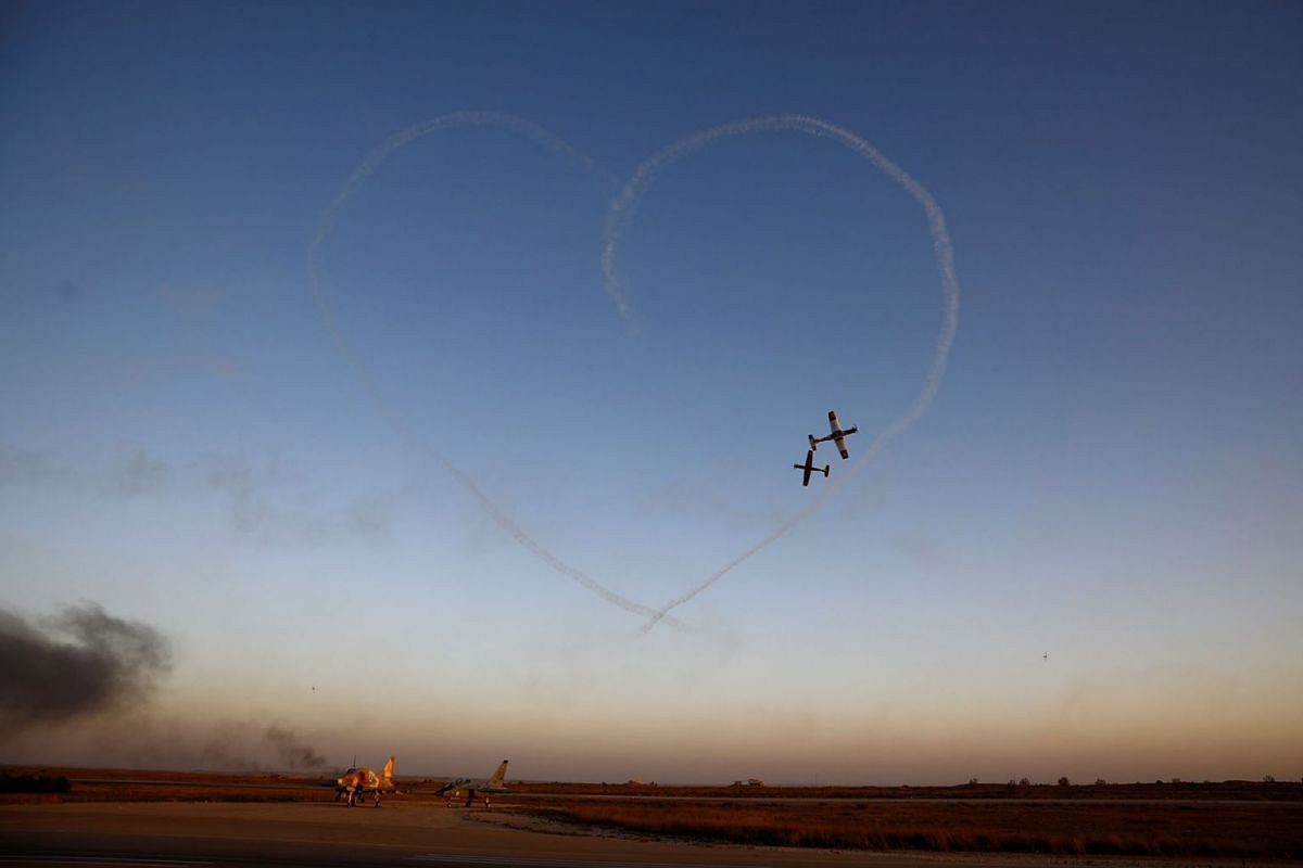 Israeli Air Force T-6 Texan II planes fly during an aerial demonstration at a graduation ceremony for Israeli Air Force pilots at the Hatzerim Airbase in southern Israel June 27, 2019. PHOTO: REUTERS