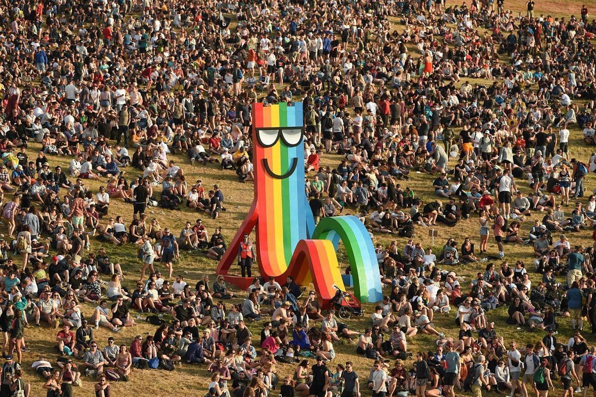Revellers attend the Glastonbury Festival of Music and Performing Arts on Worthy Farm near the village of Pilton in Somerset, South West England, on June 26, 2019. PHOTO: AFP