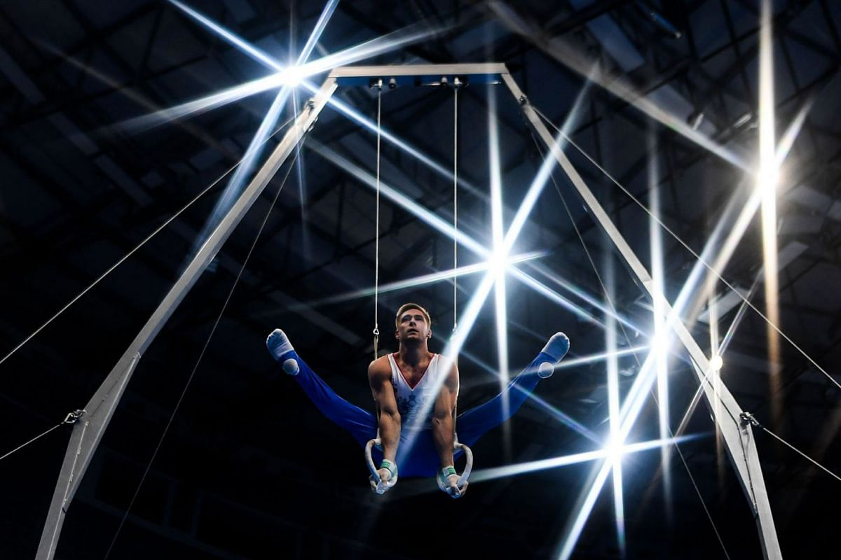 Russia's Vladislav Poliashov competes in the rings event of the men's all-around qualification of the Artistic Gymnastics at the 2019 European Games in Minsk on June 27, 2019. PHOTO: AFP