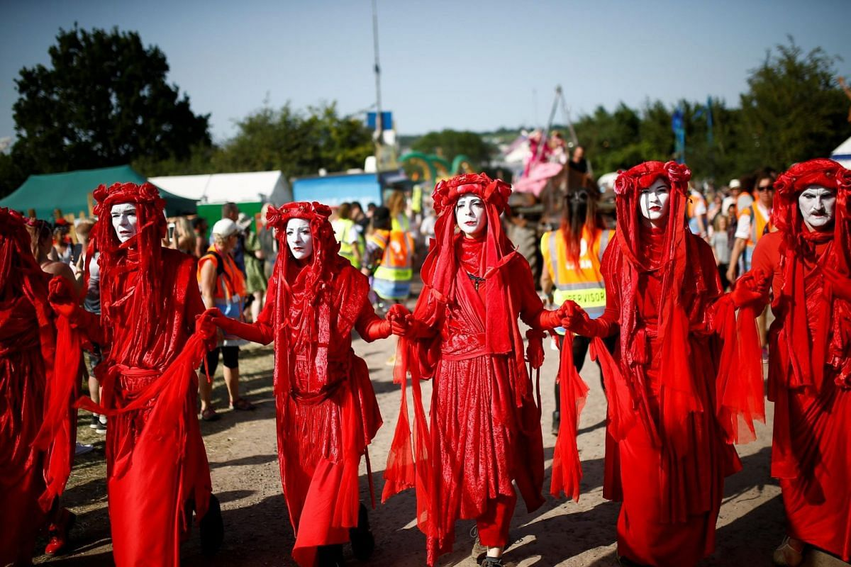 Protesters affiliated with the Extinction Rebellion taking part in a procession during the Glastonbury Festival on June 27, 2019.